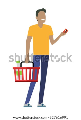 Man with shopping basket. Smiling man in yellow t-shirt and blue pants. Holding credit card. Man daily shopping, customer in mall, supermarket shopping, retail store illustration in flat