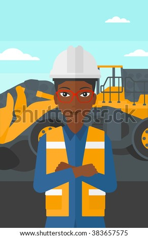 Miner with mining equipment on background.