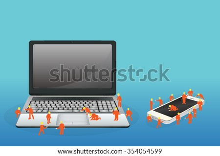 mini worker working on a laptop computer and smartphone