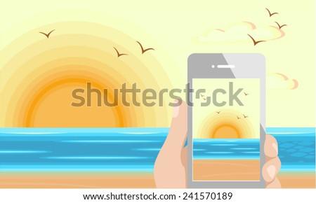 Mobile phone capturing the sunrise beach - stock vector