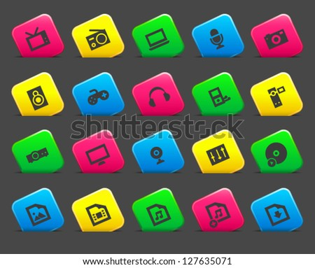 Multimedia icons on colored cut square buttons. Image contains transparency - you can put it on every surface. 10 EPS - stock vector