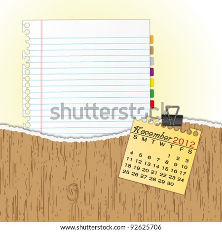 New paper sheet in rip wood folder and hold  2012 calendar november by paper clip. - stock vector