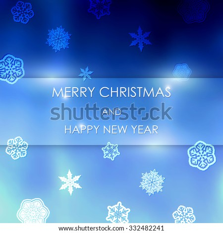 New year blue blurred background with snowflakes with text Marry Christmas And Happy New Year