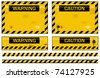 Old worn grungy yellow and black warning signs - stock photo