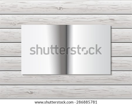 Open book on wooden table - stock vector