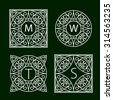 Ornate frames for monograms or other symbols in arabesque style; dark green. The letters are replaceable.