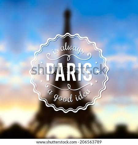 Paris typographic design on blurred Eiffel tower background - stock vector
