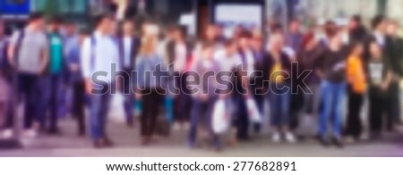 People walking on the street. Blurred Image Background.