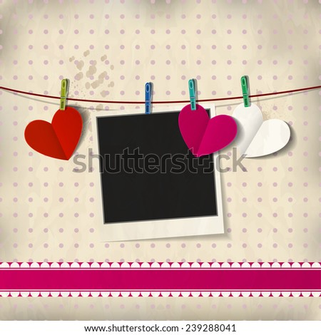 Photo card with paper hearts on vintage background.