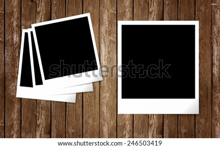 Photo frames on vintage wooden background. Vector illustration.