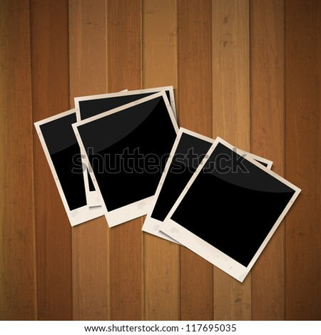 Photo frames on wooden background.Vector illustration - stock vector