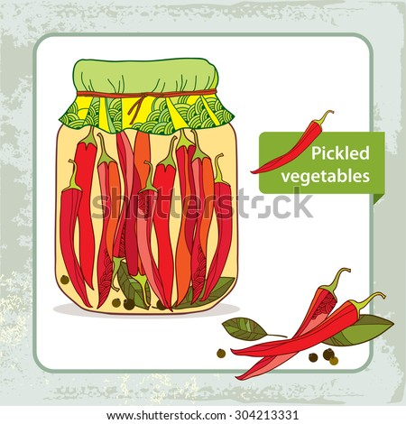 Pickled red chili peppers in the glass jar with bay leaf and black ...