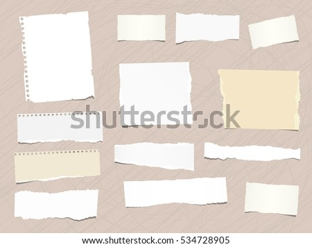 Pieces of different size ripped note, notebook, copybook paper stuck brown background