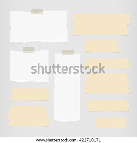 Pieces of ripped white blank note paper, brown sticky, adhesive tapes are stuck on gray wall