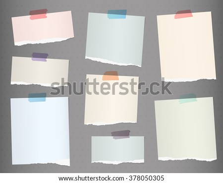 Pieces of torn colorful blank note paper on gray background