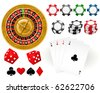 Playing cards, Roulette Wheel and gambling chips - stock photo