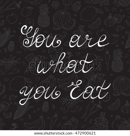"Poster lettering ""You Are What You Eat"" with abstract vegetables and fruits. Healthy lifestyle motivation concept. Inspirational motivational quote for healthy eaters. Modern calligraphy Vector"