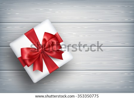 Present Gift Box with Bow on Wooden Background - stock vector