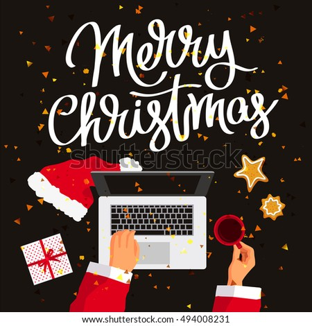 Quote Merry Christmas. Santa Claus At His Laptop. Cup Of Coffee, Gift Box