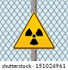 radioactive warning sign on wire fence - stock vector