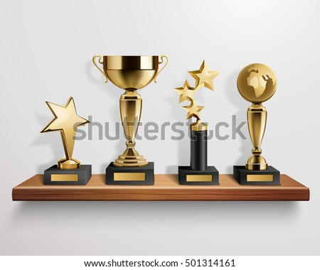 Realistic shiny golden trophy awards on wooden shelf on grey background vector illustration