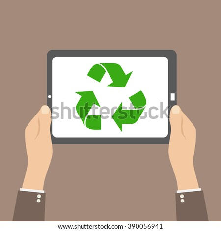 Recycle symbol in tablet, hands hold device