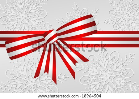 Red and white peppermint stripe Christmas ribbon bow with silver and white snowflake background.
