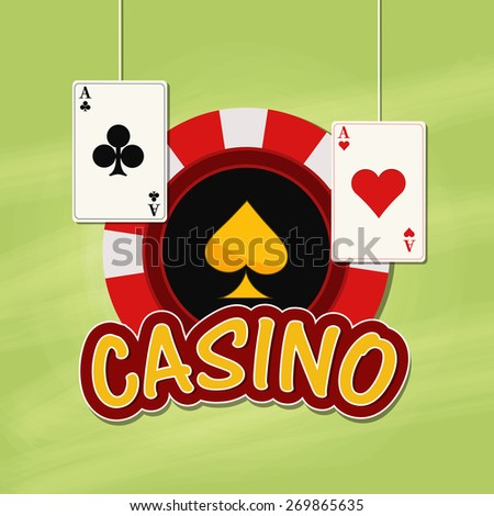 Red casino chip with hanging playing card on grungy green background.