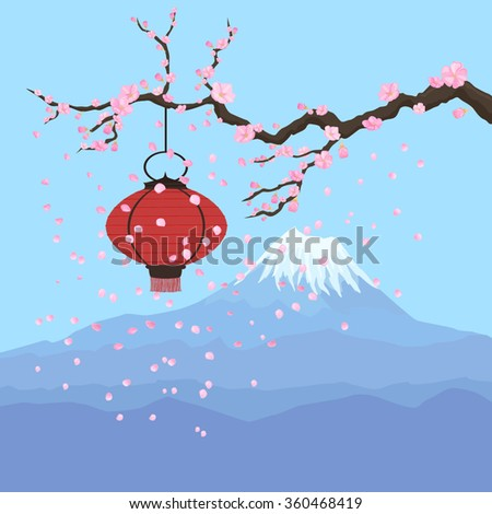 Red lantern hanging on a sakura branch in front of Fuji mountain