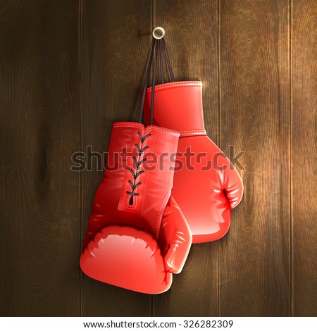 Red realistic boxing gloves hanging on wooden wall vector illustration - stock vector