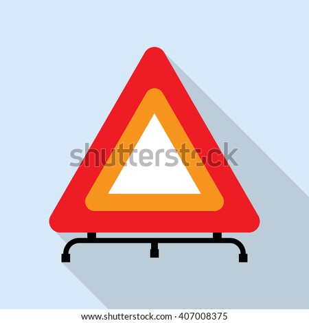 Red reflecting traffic warning triangle