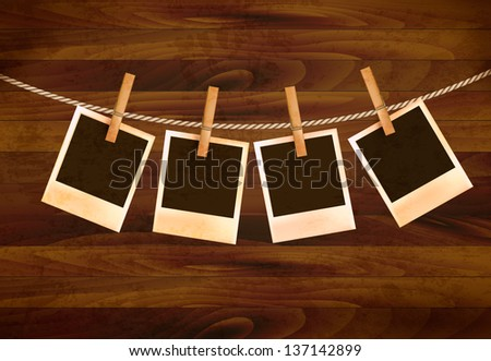 Retro photos hanging on a rope on dark wooden background. Vector. - stock vector