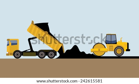 road roller and truck making road