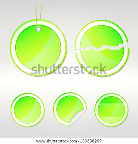 Round sticker set as green glossy emblems in five variations, eps10 vector copyspace design elements - stock vector