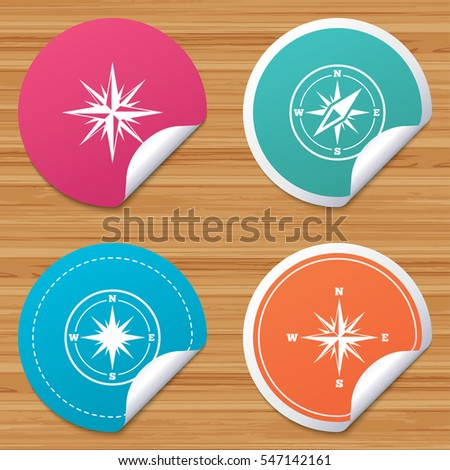 Round stickers or website banners. Windrose navigation icons. Compass symbols. Coordinate system sign. Circle badges with bended corner. Vector