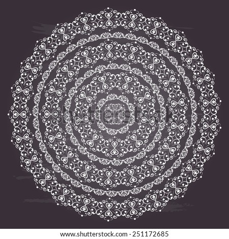 Round swirly design element isolated on chalkboard background. Circle pattern borders in white colors. Vector illustration. Could be used for web-design, decoration, etc.  - stock vector