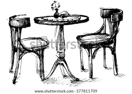 round wooden table and two chairs in Vienna