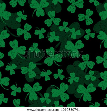 Saint Patricks Day. Vector illustration. Black background with a shamrock. Seamless Pattern. Grunge effect, scrapes