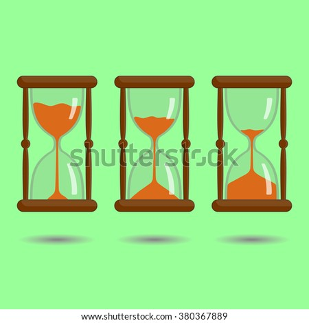 Sandglass with orange sand on green background