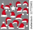 Santa caps isolated on grey background. Vector holidays icons collection. - stock vector