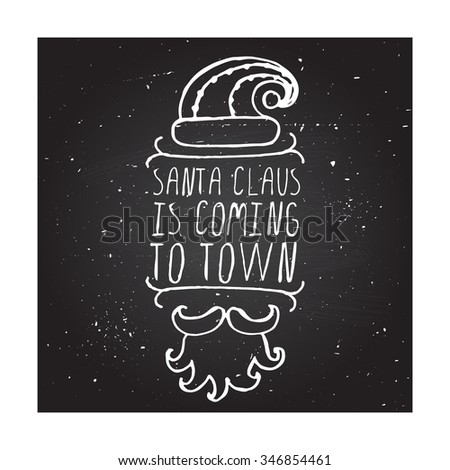 Santa Claus is coming to town - Christmas typographic element. Hand sketched graphic vector element with text, hat, mustache and beard of Santa Claus on chalkboard background. - stock vector