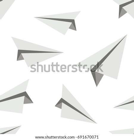Seamless abstract vector pattern. Grey paper planes put randomly on white background. Gift wrapping paper. Bed sheets and interior.