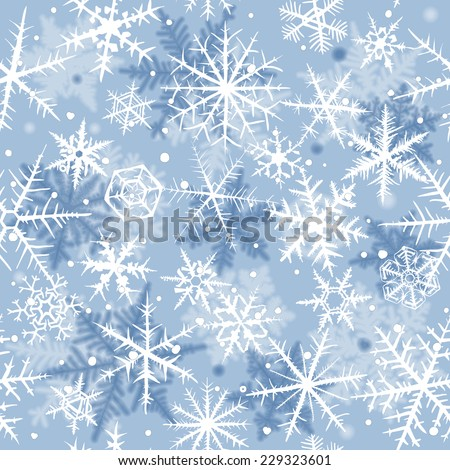 Seamless background with beautiful various snowflakes.