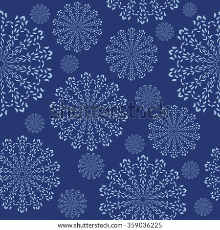 Seamless ornament with a snowflakes in abstract style
