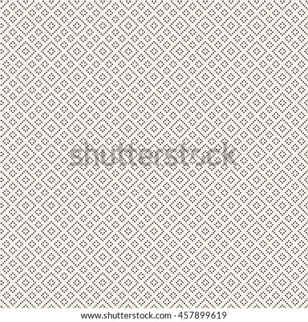 Seamless pattern. Modern stylish small dotted texture. Regularly repeating geometric tiles with dotted rhombus, diamond. Vector abstract background
