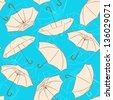 seamless pattern with beige umbrellas on blue background. vector illustration - stock vector
