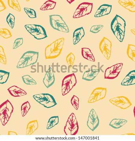 Seamless pattern with colorful leaves on a pale yellow background