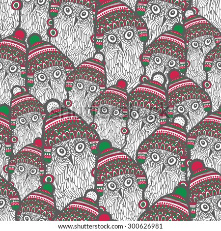 Seamless pattern with cute owls in winter hats. Vector background for the holidays. - stock vector