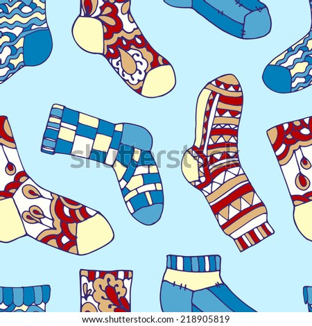 Seamless pattern with decorated socks. Socks with red, yellow. blue, white and orange ornament on a blue background. - stock vector