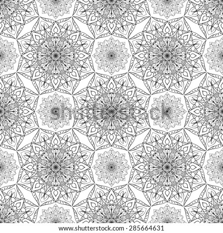 Seamless vector ethnic ornament. Detailed openwork pattern of mandalas on a white background. Template for tissue. - stock vector